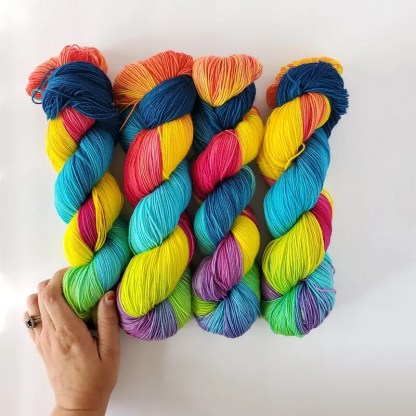 hand-dyed skeins of rainbow yarn in the colorway 'chroma'