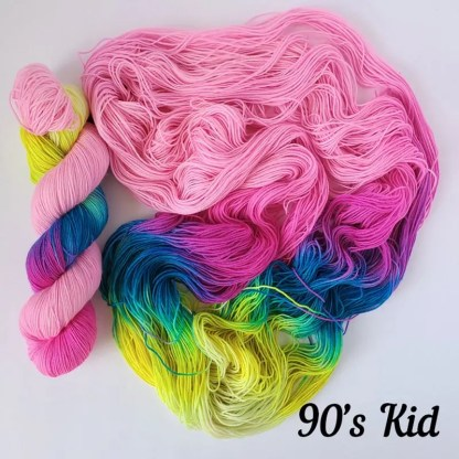 '90s kid' colorway, there is a skein on the left and an opened up skein on the right that shows how the colors flow into each other. text on the right bottom corner specifies the colorway name.