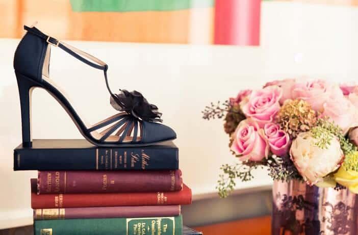 Black heels sandal on books