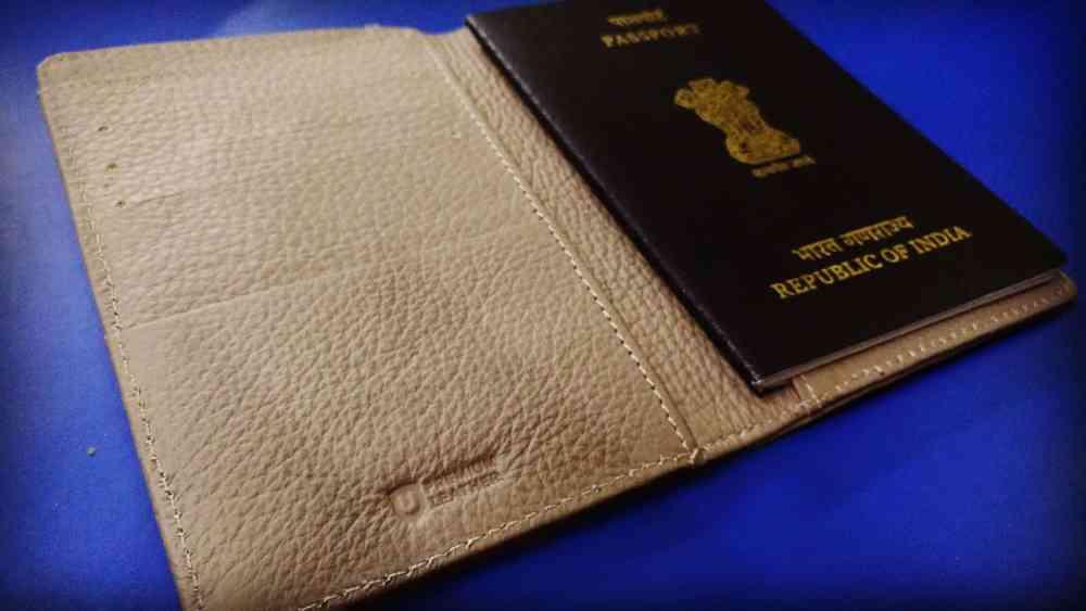 Urby passport holder thickness with passport inside
