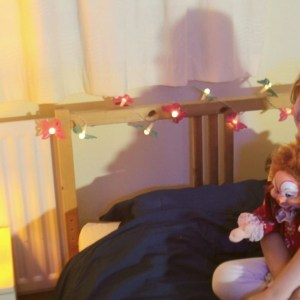 Lucy Hollis with toy clown