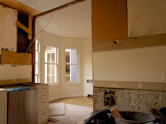 Wide Angle View of Kitchen and Pantry with Range, Hood & Cabinets and Dividing Wall Removed, Day Two