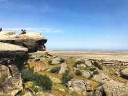 The 'lion faced rock' that overlooks a vast stretch of plain land and the sea.