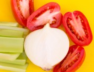 """Celery and onions, the other parts of the cooking """"Holy Trinity"""" along with tomatoes"""