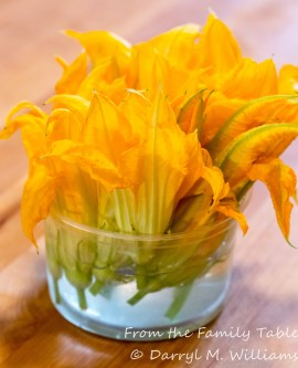 Squash blossom stems in chilled water to preserve freshness