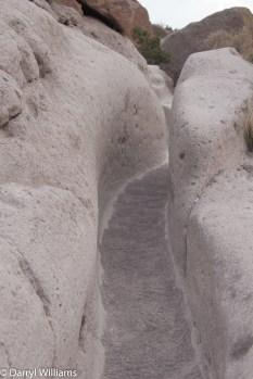 Path to Tsankawi Ruins carved through the tuff layer