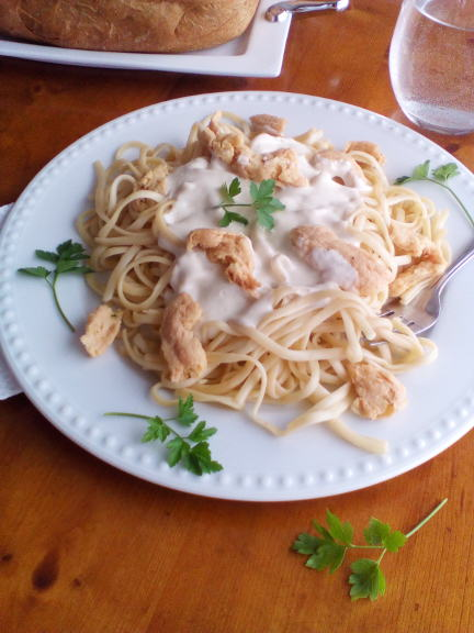 "Vegan ""Chicken"" Alfredo on a white plate top view"