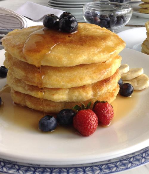 fluffy cornmeal pancakes, with maple syrup running down