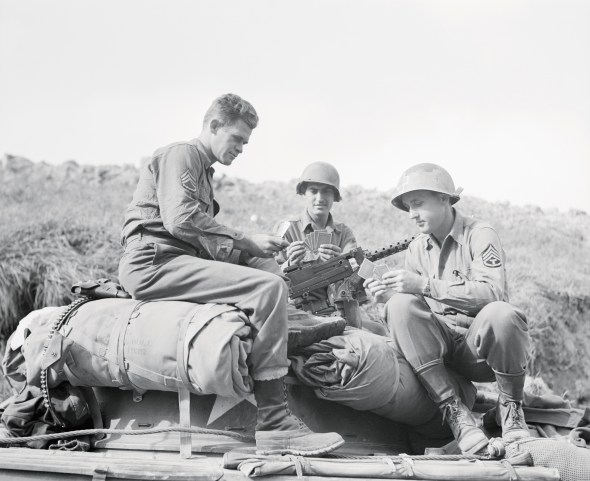 US Soldiers Playing Cards During Break in Fighting