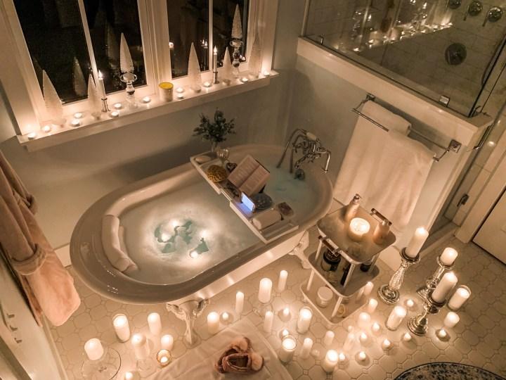 clawfoot bathtub with candles