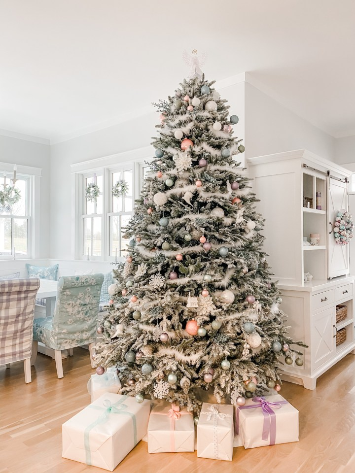 flocked Christmas tree with pink and blue ornaments