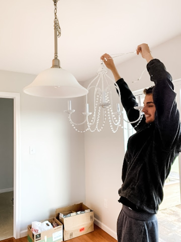 Corey hanging new chandelier