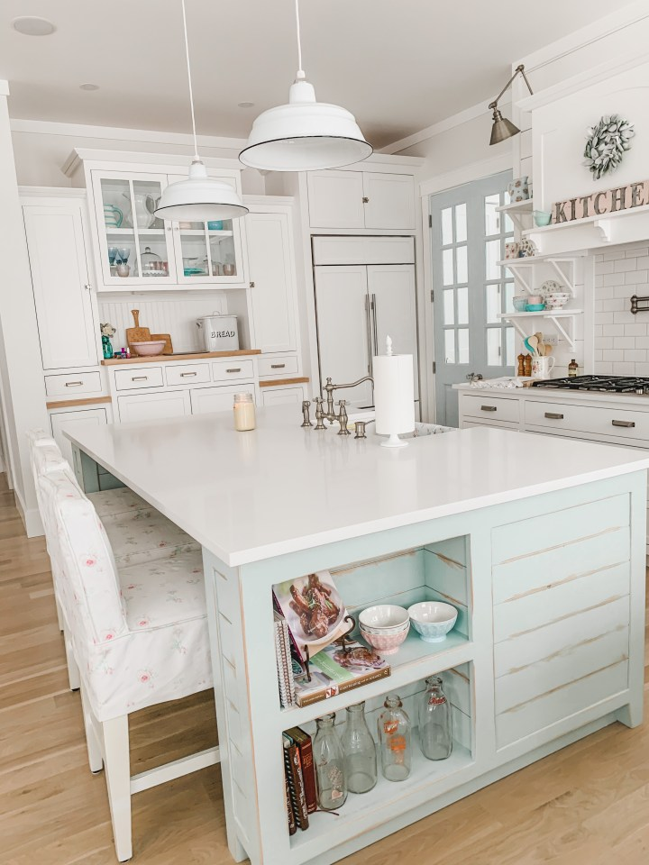 blue kitchen island with white cabinetry