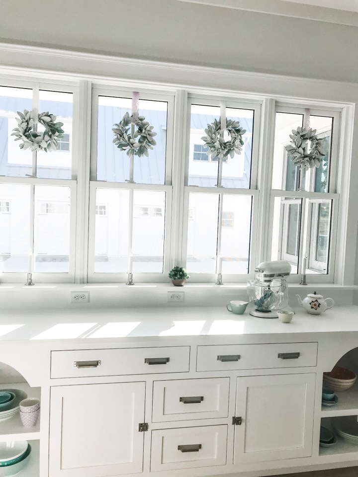 windows above kitchen cabinetry
