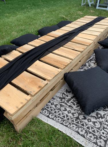black table runner on pallets