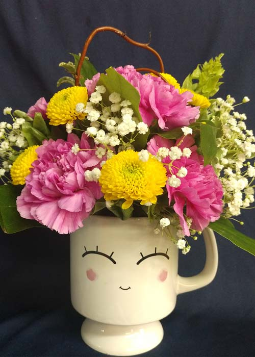 Coffee Mug Filled With Carnations Mums Babies Breath Bouquet