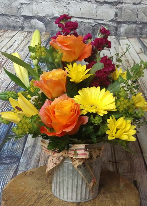 Lilies Roses Gerber Daisy Stock Flowers in a Galvanized Can Bouquet
