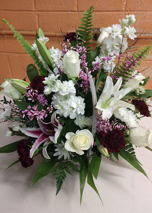 basket of lilies, stock, roses and fillers