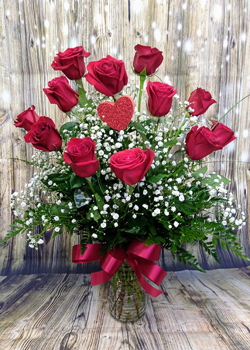 Valentine's day bouquet of a dozen roses. From the Heart Florist