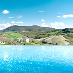 Borgo Tranquillo, villa rental in Le Marche, Italy. Beautiful view of the countryside from the infinity pool