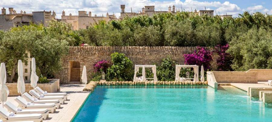 Borgo Egnazia a luxury hotel near the beach and with heated pool. Read the post for more places like this.