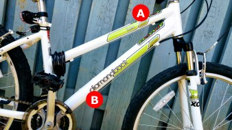 A) Top tube: this connects the head tube to the top of the seat tube. The angle here really varies. Mine is angled downwards which is great for passing your leg through. Tip: if your top tube makes getting it on and off a bike rack a nightmare, try a top tube adapter. B) Down tube: connects the head tube to the bottom bracket where you'll find the front deraileur.