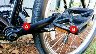 "A) Crank: these are the ""arms"" that attach the pedals to the crankset and chain rings, B) Pedal: These make up 2 points of contact with the bike where your feet are placed."