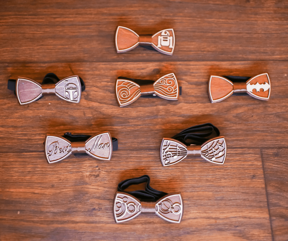 Nerdy Rustic Barn Wedding | Bow ties | Wooden Bow ties | Bride | Sherri Hill| Wedding Dress | Burgundy | Cranberry | pink | gold | woodsy | eucalyptus | wedding invitation | woodland invitation | pine trees | Table Centerpiece | Reception | Wedding | Rustic Wedding | Woodland Wedding | Old McMickey's Farm | The Barn at Crescent Lake | wedding ideas | Centerpieces | Decorations | Wood slices | Nerdy wedding | Rustic | Big Day | Harry Potter | Supernatural | Starwars | Lord of The Rings | Doctor Who | outdoor | barn wedding | Barn bride |