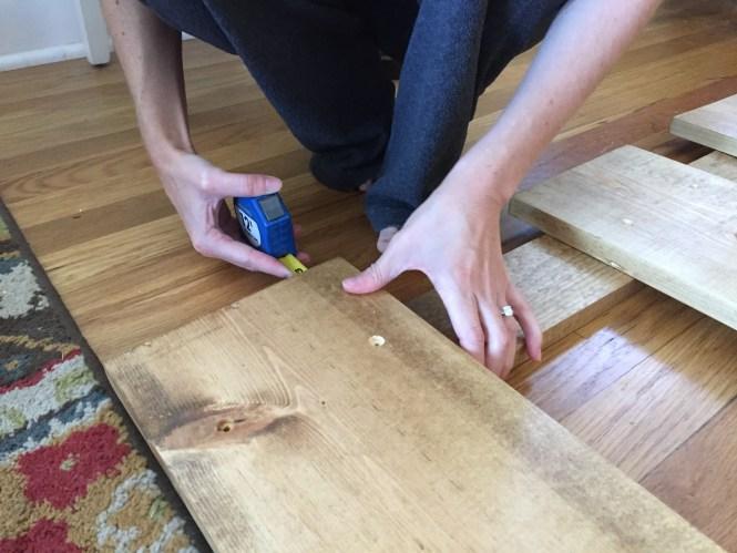Measure each side to line up vertical headboard legs