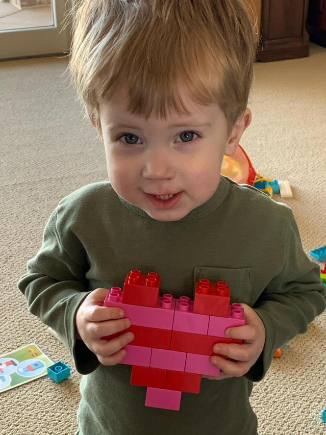 Henry with lego heart