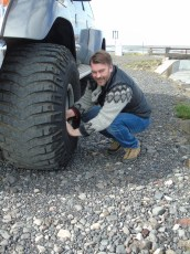 Jon from PTI adjsuting the tire pressure in our SuperJeep.
