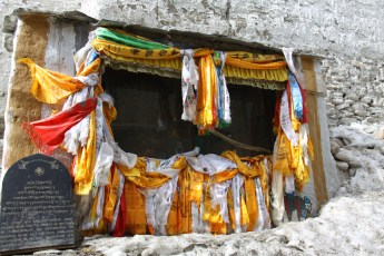 Outdoor temple, Lo Manthang strewn with prayer scarves