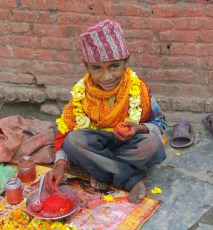 Little boy selling flowers for pujas