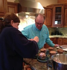 Steve teaching Tina to make chocolate souffles