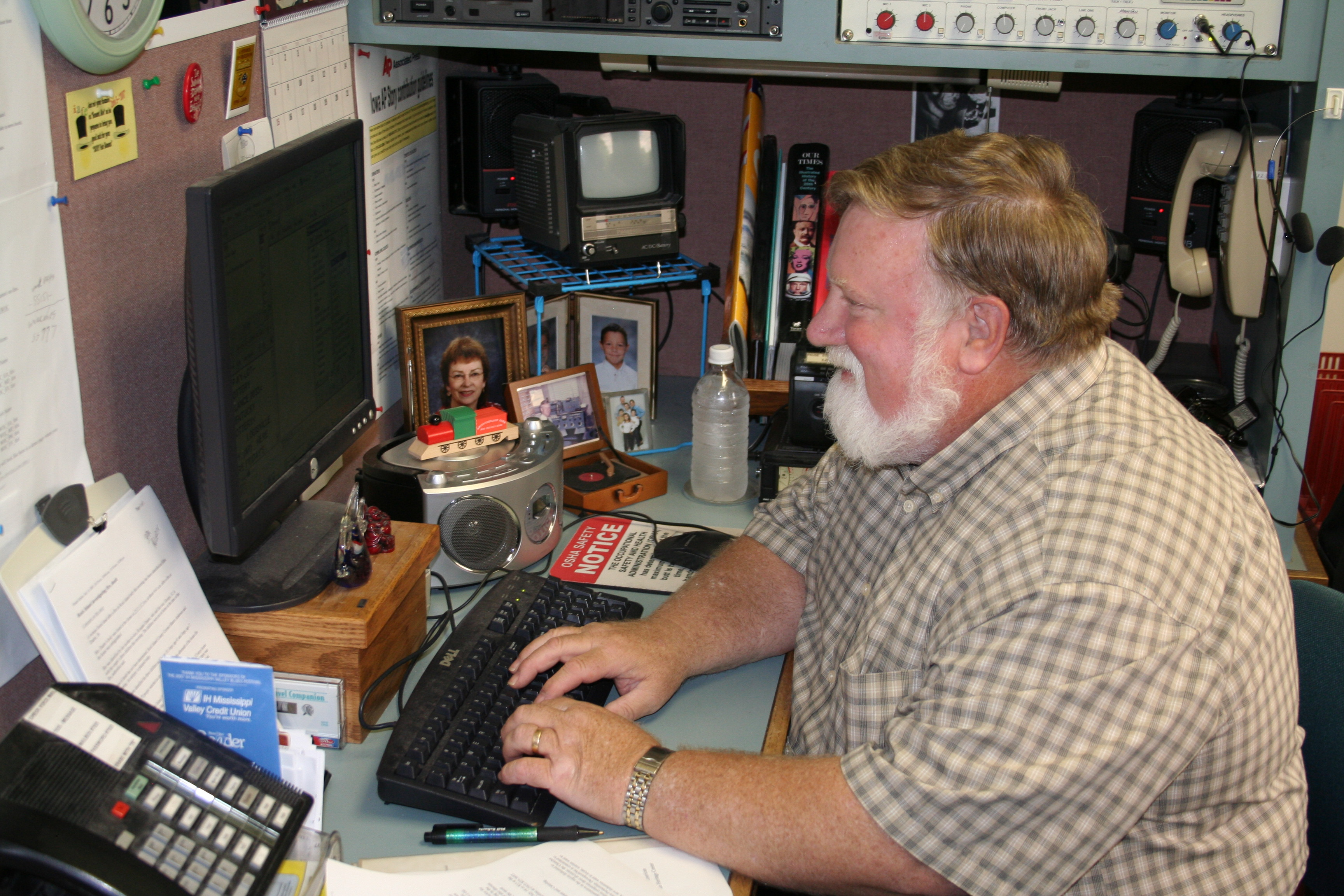 I spend much of each day at the computer writing, as this July 2007 photo indicates.