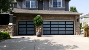 Modern Classic brown garage door with glass in Denver