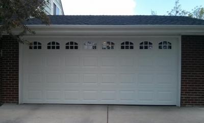 White Insulated Steel, traditional style garage door with decorative windows