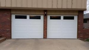 Two Small garage doors with windows at the top