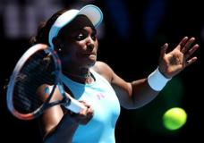 Sloane Stephens of the United States hits a forehand return to Wang Qiang of China during their first round match at the Australian Open tennis championships in Melbourne, Australia, Monday, Jan. 18, 2016.(AP Photo/Rick Rycroft)