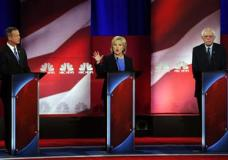Democratic presidential candidate, Hillary Clinton, center, speaks at the NBC, YouTube Democratic presidential debate at the Gaillard Center, Sunday, Jan. 17, 2016, in Charleston, S.C. To the left is Democratic presidential candidate, former Maryland Gov. Martin O'Malley and Democratic presidential candidate, Sen. Bernie Sanders, I-Vt, left. (AP Photo/Mic Smith)