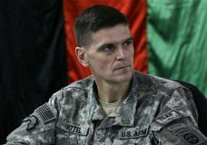 FILE - In this Feb. 24, 2007, file photo, then-U.S. Brig. Gen. Joseph Votel listens in front of an Afghan national flag during a meeting with Afghan officials in an Afghan military base in Kabul, Afghanistan. A senior U.S. defense official says President Barack Obama is expected to choose Army Gen. Joseph Votel, commander of U.S. Special Operations Command, to succeed Army Gen. Lloyd Austin. (AP Photo/Musadeq Sadeq, File)