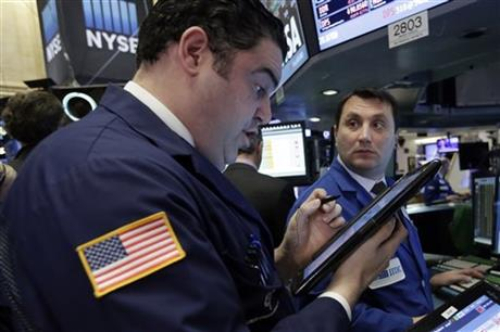 Trader Robert McQuade, left, and specialist Vincent Surace work on the floor of the New York Stock Exchange, Wednesday, Jan. 20, 2016. Energy stocks are leading another sell-off on Wall Street as the price of oil continues to plunge. (AP Photo/Richard Drew)