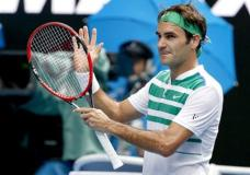Roger Federer of Switzerland celebrates after defeating Alexandr Dolgopolov of Ukraine in their second round match at the Australian Open tennis championships in Melbourne, Australia, Wednesday, Jan. 20, 2016.(AP Photo/Vincent Thian)