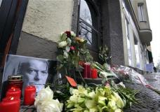 "Flowers and a portrait are placed in front of the apartment building where David Bowie once lived in Berlin, Germany, Monday, Jan. 11, 2016, to honor the British musician. Bowie, the innovative and iconic singer whose illustrious career lasted five decades with hits like ""Fame,"" ''Heroes"" and ""Let's Dance,"" died Sunday after a battle with cancer. He was 69. (AP Photo/Michael Sohn)"