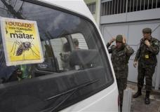"""Army soldiers prepare for a clean up operation against the Aedes aegypti mosquito, which is a vector for transmitting the Zika virus, in Sao Paulo, Brazil, Thursday, Jan. 28, 2016. The sticker reads in Portuguese """" Beware, this mosquito can kill """". (AP Photo/Andre Penner)"""