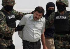 """FILE - In this Feb. 22, 2014 file photo, Joaquin """"El Chapo"""" Guzman is escorted to a helicopter in handcuffs by Mexican navy marines at a navy hanger in Mexico City, Mexico. Mexican President Enrique Pena Nieto posted on his Twitter account, Friday, Jan. 8, 2016, that drug lord Joaquin 'Chapo' Guzman has been recaptured. (AP Photo/Eduardo Verdugo, File)"""