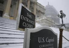 Fresh snow covers the steps of the U.S.Capitol in Washington January 23, 2016. REUTERS/Jonathan Ernst