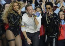Beyoncé, Coldplay singer Chris Martin and Bruno Mars perform during halftime of the NFL Super Bowl 50 football game Sunday, Feb. 7, 2016, in Santa Clara, Calif. (AP Photo/David J. Phillip)