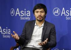 "FILE - In this Oct. 12, 2015, file photo, Manny Pacquiao takes questions at the Asia Society in New York. Boxing star Pacquiao has created a firestorm in his home country after saying people in same-sex relationships ""are worse than animals."" Pacquiao, who is running for a Philippine Senate seat, made the remark in a video posted Monday, Feb. 15, 2016, on local TV5's election site. He also said animals are better than people in same-sex relationships because they recognize the difference between males and females. (AP Photo/Seth Wenig, File)"