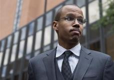 FILE - In this Aug. 14, 2014, file photo, Chaka Fattah Jr. stands outside the U.S. Courthouse in Philadelphia. Fattah Jr., son of a veteran Philadelphia congressman, was sentenced Tuesday, Feb. 2, 2016, to five years in federal prison on bank and tax fraud convictions. (AP Photo/Matt Rourke, File)